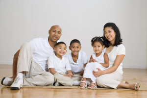Portrait of multi-ethnic family on floor